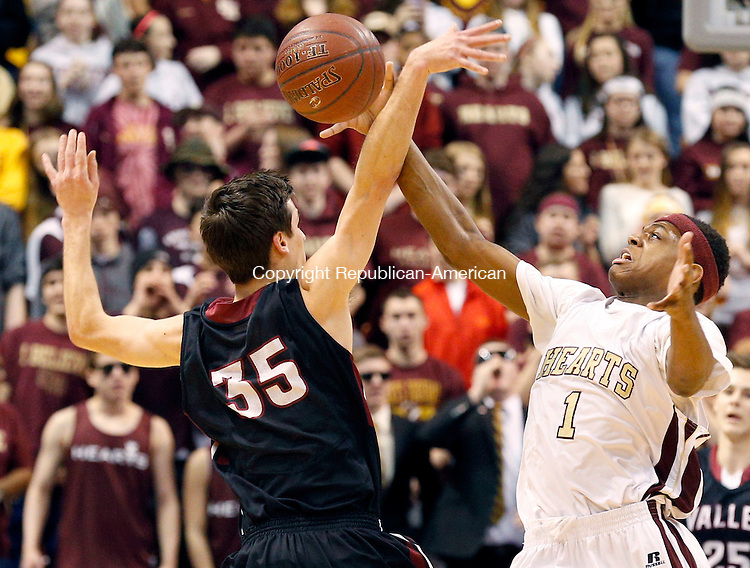 Uncasville, CT- 22 March 2015-032215CM22- Sacred Heart's Malik Petteway goes after the ball against Valley Regional's Hunter Linfesty during the Class S state championship game at Mohegan Sun Arena in Uncasville on Sunday.  The Hearts won, 71-46.   Christopher Massa Republican-American