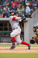 Bryce Brentz (25) of the Pawtucket Red Sox follows through on his swing against the Charlotte Knights at BB&T Ballpark on August 9, 2014 in Charlotte, North Carolina.  The Red Sox defeated the Knights  5-2.  (Brian Westerholt/Four Seam Images)