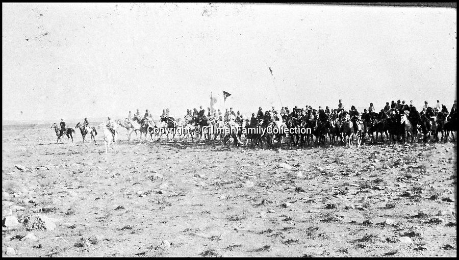 Bournemouth News (01202 558833)<br /> Pic: GilmanFamilyCollection/BNPS<br /> <br /> Feisul's Northern Arab Army on the move.<br /> <br /> Fascinating never before seen photos of the Arab Revolt have revealed Lawrence of Arabia actually had help from a plucky band of British troops as well as the Arab tribesmen.<br /> <br /> A new book reveals the legendary campaign, that did much to shape the modern map of the Middle East, used cutting edge weapons like Rolls Royce armoured car's and British crewed aircraft to attack the Turkish enemy alongside the native arab army.<br /> <br /> The photos feature in military historian James Stejskal's new book Masters of Mayhem which sheds new light on T.E Lawrence's achievements fighting alongside Arab guerrilla forces in the Middle East during the First World War.<br /> <br /> They had been tucked away in the private photo albums of the descendants of soldiers who fought alongside Lawrence during the campaign.<br /> <br /> One historically important photo shows Lawrence and his driver sitting in a Rolls Royce in Marjeh Square in Damascus after it was captured in October 1918.<br /> <br /> Another documents the dramatic moment a water tower and windmill pump are blown up in the desert.