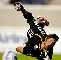 Chicago Fire goalkeeper Matt Pickens (18) dives to make a save.  The Chicago Fire defeated the New England Revolution 2-1 in the quarterfinals of the U.S. Open Cup at Toyota Park in Bridgeview, IL on August 23, 2006...