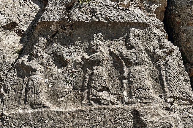 Procession of female Gods in the 13th century BC Hittite religious rock carvings of Yazılıkaya Hittite rock sanctuary, chamber A,  Hattusa, Bogazale, Turkey.