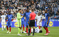 Paul Pogba (Manchester United) of France and Hugo Lloris (Tottenham Hotspur) of France talk to referee before the sending off of Raphael Varane (Real Madrid) of France during the International Friendly match between France and England at Stade de France, Paris, France on 13 June 2017. Photo by David Horn/PRiME Media Images.