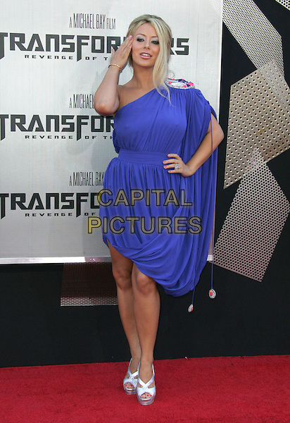 "AUBREY O'DAY.""Transformers: Revenge of the Fallen"" 2009 Los Angeles Film Festival Premiere held at Mann's Village Theatre, Westwood, CA, USA..June 22nd, 2009.full length blue purple draped dress sheer grecian one sleeve hand on hip silver shoes shoulder.CAP/ADM/MJ.©Michael Jade/AdMedia/Capital Pictures."