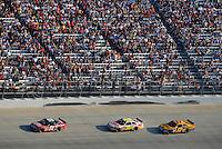 Sept. 21, 2008; Dover, DE, USA; Nascar Sprint Cup Series driver Carl Edwards (99) leads teammates Greg Biffle (16) and Matt Kenseth (17) during the Camping World RV 400 at Dover International Speedway. Mandatory Credit: Mark J. Rebilas-
