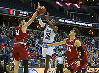 Washington, DC - March 10, 2018: Rhode Island Rams guard Jared Terrell (32) gets fouled by Saint Joseph's Hawks forward Taylor Funk (33) during the Atlantic 10 semi final game between Saint Joseph's and Rhode Island at  Capital One Arena in Washington, DC.   (Photo by Elliott Brown/Media Images International)