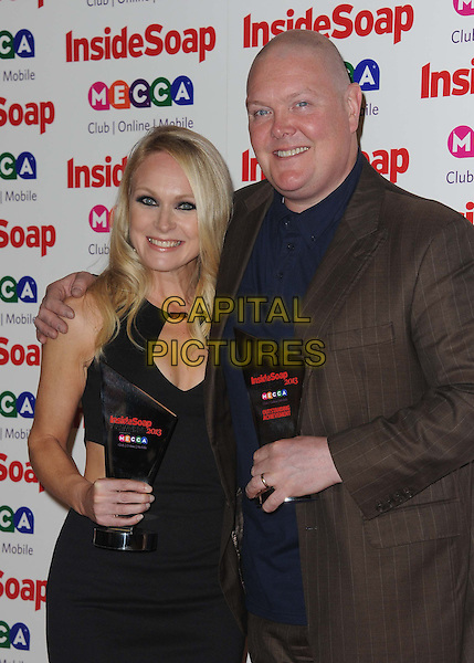Michelle Hardwick &amp; Dominic Brunt<br /> Inside Soap Awards at Ministry Of Sound, London, England.<br /> 21st October 2013<br /> half length dress black award trophy winner blue shirt brown suit jacket<br /> CAP/DS<br /> &copy;Dudley Smith/Capital Pictures