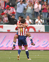 CD Chivas's Francisco Gomez jumps into the arms of teammate Ante Razov after scoring a goal against Real Salt Lake in the first half at the Home Depot Center in Carson, CA on Saturday night, April 2, 2006. (Matt A. Brown/ISI)