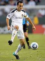 LA Galaxy midfielder Landon Donovan passes off the ball for an assist. The LA Galaxy defeated FC Dallas 2-1 at Home Depot Center stadium in Carson, California on Sunday October 24, 2010.
