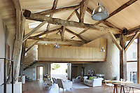 The open-plan living, dining and occasional party space in the converted barn