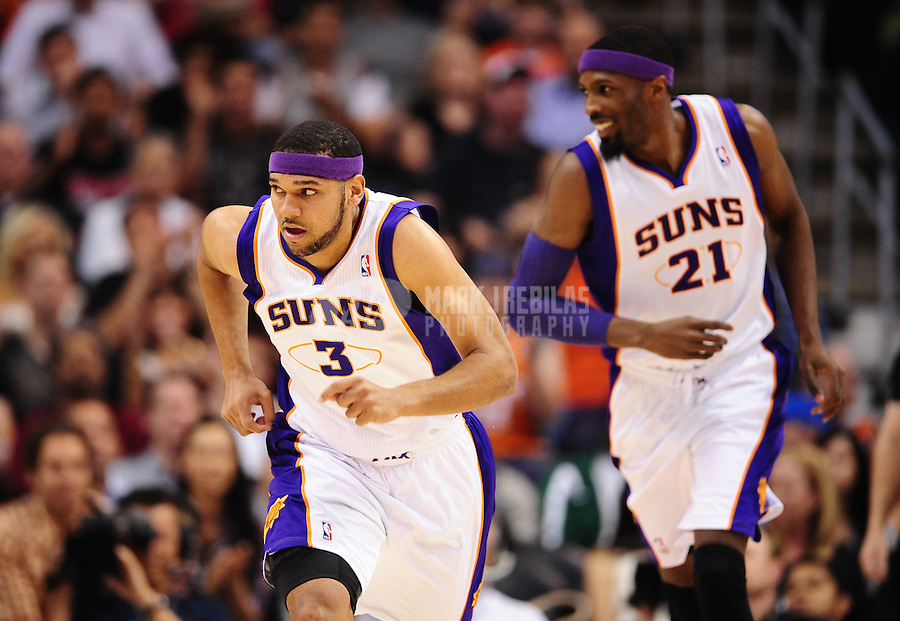 Mar. 30, 2011; Phoenix, AZ, USA; Phoenix Suns forward (3) Jared Dudley and forward (21) Hakim Warrick against the Oklahoma City Thunder at the US Airways Center. Mandatory Credit: Mark J. Rebilas-.