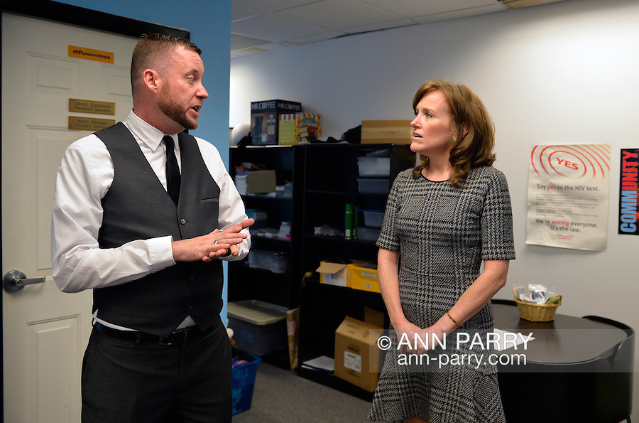 Bellmore, New York, USA. September 16, 2014. KATHLEEN RICE, Democratic congressional candidate (NY-04), speaks with PETE CARNEY, Director of Pride For Youth, a program that provides services for lesbian, gay, bisexual and transgender youth and their families. Rice, joined by local LGBT actvitists, called for congressional action both to pass legislation prohibiting employment discrimination on basis of sexual orientation and gender identity, and to fully repeal the Defense of Marriage Act. Pride For Youth is a division of the Long Island Crisis Center. Rice is in her third term as Nassau County District Attorney.