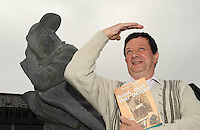 Micheal DeMordha pictured with of my  book 'Sceal Agus Dan Oileain'  which records the social history of the Great Blasket island with special emphasis on the<br /> &quot;Evacuation&quot; of the island in 1953 pictured beside a statue to the Great Blasket writer, Tomas O'Criomhthain, known as 'The Islandman'. The book will be launched in The Blasket Centre in Dun Chaoin on Friday night.<br /> Picture by Don MacMonagle