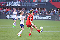 Portland, OR - Saturday, May 21, 2016: Portland Thorns FC midfielder Lindsey Horan (7) is marked by Washington Spirit midfielder Joanna Lohman (15). The Portland Thorns FC defeated the Washington Spirit 4-1 during a regular season National Women's Soccer League (NWSL) match at Providence Park.