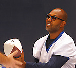 Torry Holt hands an autographed football back to a fan.