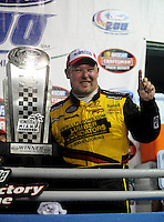 Nov. 14, 2008; Homestead, FL, USA; NASCAR Craftsman Truck Series driver Todd Bodine celebrates after winning the Ford 200 at Homestead Miami Speedway. Mandatory Credit: Mark J. Rebilas-