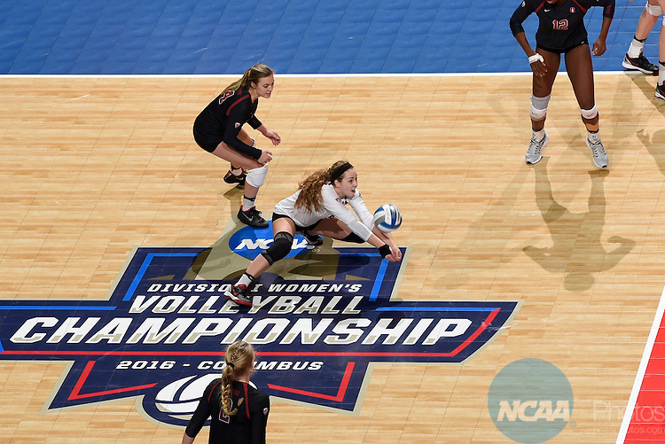 COLUMBUS, OH - DECEMBER 17:  Morgan Hentz (9) of Stanford University digs the ball against the University of Texas during the Division I Women's Volleyball Championship held at Nationwide Arena on December 17, 2016 in Columbus, Ohio.  Stanford defeated Texas 3-1 to win the national title. (Photo by Jamie Schwaberow/NCAA Photos via Getty Images)