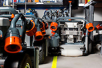 The HV-100 robot is a device for automating material handling in agriculture, such as potted plants and saplings, made by Harvest Automation in North Billerica, Massachusetts, USA.  The robots use a yellow line placed on the ground to navigate between plants.