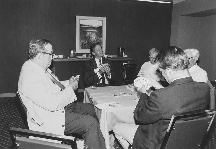 Rep. Arlan Stangeland, R-Minn., playing card game with party members. (Photo by CQ Roll Call)