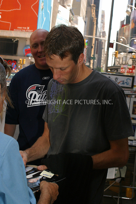 WWW.ACEPIXS.COM . . . . .  ....NEW YORK, JULY 22, 2005....Tony Hawk takes a moment to sign for fans outside MTV'S TRL.....Please byline: PAUL CUNNINGHAM - ACE PICTURES..... *** ***..Ace Pictures, Inc:  ..Craig Ashby (212) 243-8787..e-mail: picturedesk@acepixs.com..web: http://www.acepixs.com