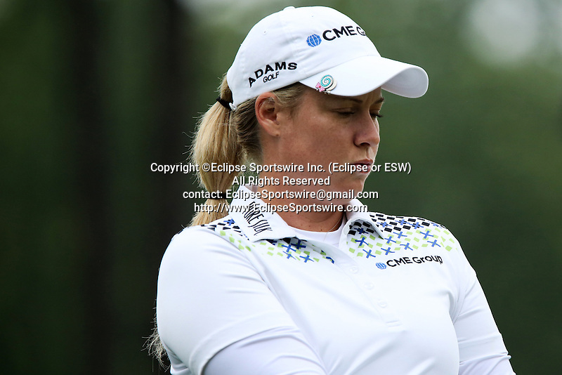 American Brittany Lincicome reacts after making a birdie by chipping her ball into the first hole at the LPGA Championship at Locust Hill Country Club in Pittsford, NY on June 7, 2013