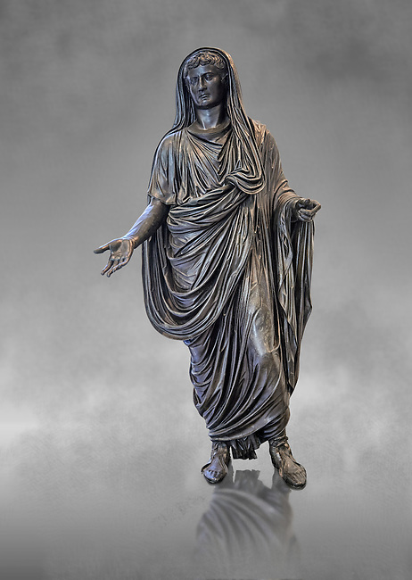 Roman bronze staue of Augustus Ceasar as Pontifex Maximus, late first century B.C, Naples National Archaeological Museum, grey art background