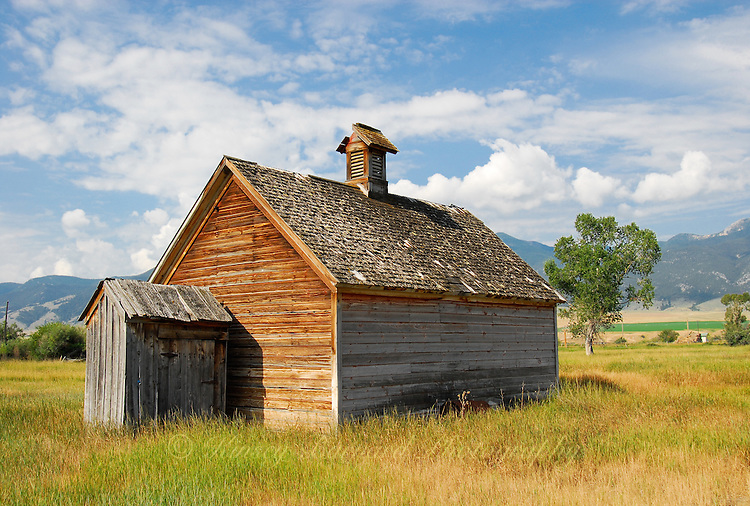 &quot;MONTANA SCHOOL HOUSE&quot;<br /> <br /> 40 X 30 USD 3,500<br /> 36 X 24 USD 2,800<br /> <br /> 16 x 12.5 Paper print. Signed &amp; numbered.<br /> 1/50 $95.00<br /> <br /> An old Montana schoolhouse sitting alone in a grassy field all but forgotten. The world famous Big Sky providing a spectacular background.