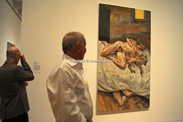 "Visitors admire a work by painter Lucian Freud in the recently unveiled Modern Wing of the Art Institute Chicago, designed by architect Renzo Piano on the first ""free Tuesday"" where admission costs nothing and is open to the public, in Chicago, Illinois on May 19, 2009."