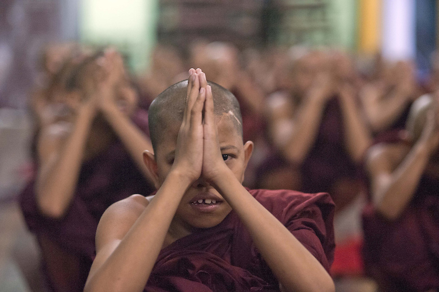 Novice monks pray at Mae Soe Yein monastery in Mandalay.  Ashin Wirathu, one of 5 head monks at the monastery, is the most vocal advocator of  the 969 movement that encourages Buddhists to only shop at Buddhist owned shops with stickers to identify them.