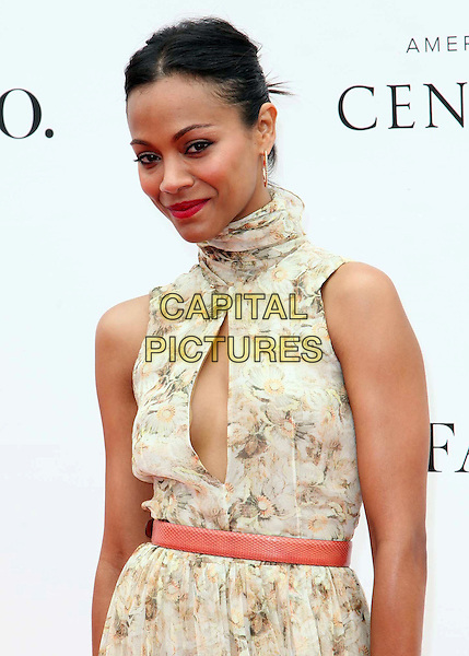 Zoe Saldana.Audi At The Foundation Polo Challenge held at the Santa Barbara Polo & Racquet Club, Santa Barbara, California, USA, 9th July 2011..half length green beige print floral dress belt cut out sleeveless clutch bag  high neck green  hoop earrings .CAP/ADM/KB.©Kevan Brooks/AdMedia/Capital Pictures.