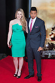 """Actor Franz Drameh with guest. First World Premiere of the new Tom Cruise and Emily Blunt movie """"Edge of Tomorrow"""" at the BFI IMAX cinema in London, United Kingdom. As the film is about reliving the events of one day over and over in an epic battle to save the world, the stars of """"Edge of Tomorrow"""" take part in a worldwide event when, for the first time ever, three fan premieres will be held in three different countries in just one day."""