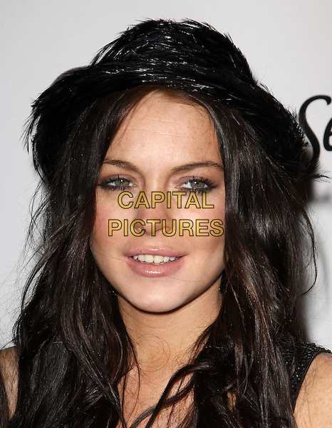 LINDSAY LOHAN.Star Magazine Celebrates Young Hollywood held at Voyeur, West Hollywood, California, USA..March 31st, 2010.headshot portrait black hat .CAP/ADM/KB.©Kevan Brooks/AdMedia/Capital Pictures.