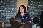 Heydi Foster, the CEO of Mision Cara, talks with students studying English at the Arrupe Learning Center in Bunj, South Sudan. The community is host to more than 130,000 refugees from the Blue Nile region of Sudan, and Misean Cara has supported Jesuit Refugee Service as it provides services to both refugees and the host community.