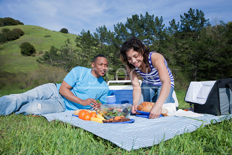 USA California, Fairfax, young couple having picnic in hilly landscape
