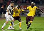 Partizan player Sasa Ilic, left in action against Arsenal players, Bacary Sagna, center and Alex Song, right,  during  UEFA Champions league match in group H FC Partizan Belgrade Vs. Arsenal, London, Serbia, Monday, Sept. 28, 2010.  (Srdjan Stevanovic/Starsportphoto.com)