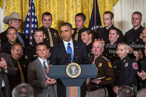 United States President Barack Obama honors the 2013 National Association of Police Organizations TOP COPS award winners in a ceremony at the White House on May 11, 2013 in Washington, DC. TOP COPS awardees are nominated by their fellow officers for outstanding service above and beyond the call of duty. <br /> Credit: Brendan Hoffman / Pool via CNP