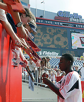 D.C. United's Freddy Adu signs autographs before the game. The New England Revolution and D.C. United finished in a scoreless tie in MLS play at Gillette Stadium, Foxboro, MA on Saturday August 28, 2004.