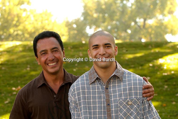 Hispanic man with his son