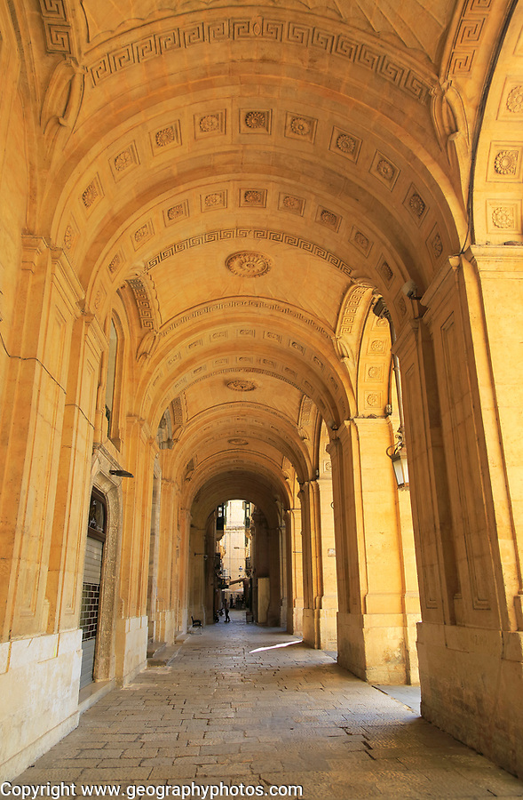 Arched stone passageway gallery National Library building, Valletta, Malta