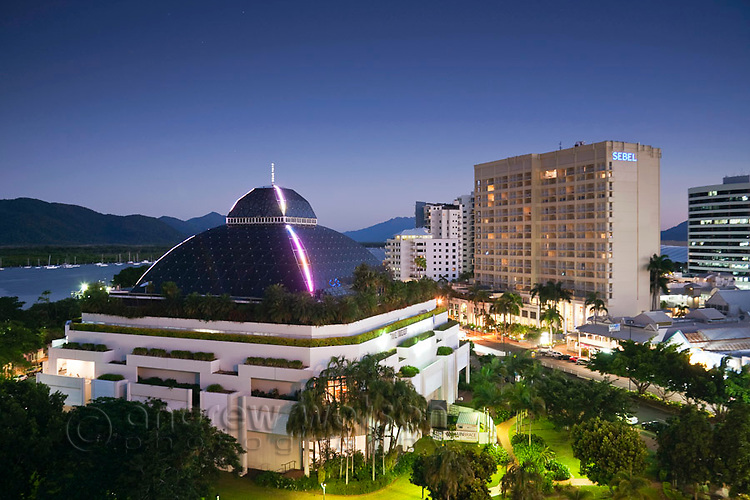 The Reef Hotel Casino and Sebel Hotel illuminated at night.  Cairns, Queensland, Australia