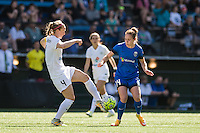 Seattle, WA - Sunday, May 1, 2016: FC Kansas City defender Becky Sauerbrunn (4) clears the ball from Seattle Reign FC forward Manon Melis (14) during the first half of the match at Memorial Stadium. Seattle won 1-0.