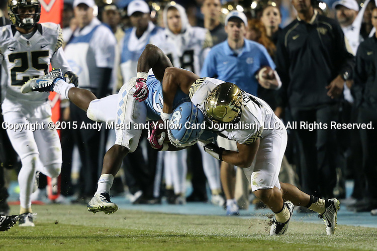 17 October 2015: UNC's Elijah Wood (34) is tackled by Wake Forest's Brandon Chubb (right). The University of North Carolina Tar Heels hosted the Wake Foresst University Demon Deacons at Kenan Memorial Stadium in Chapel Hill, North Carolina in a 2015 NCAA Division I College Football game. UNC won the game 50-14.