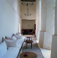 A banquette lines a corridor overlooking the central courtyard