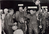 Black and white file photo, OSU football - Ohio State football . Mud-covered but happy Buckeyes celebrate their Rose Bowl victory over the USC (University of Southern California) Trojans .  Game was played January 1st 1955 .  SHOWN ARE OSU players: left to right: An unidentified player;  RICHARD S. GUY , DAVE WILLIAMS , and HUBERT BOBO. (Dispatch file photo)