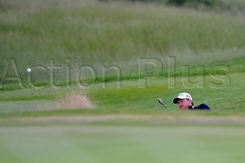 05.06.2011 Day four of the SAAB Wales Open Golf from Celtic Manor. Graeme MCDOWELL (NIR) ichips from a bunker  during the fourth and final round on the Twenty Ten course.