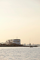 A passenger ferry, which transports people up and down the Niger River, is moored at the dock in Segou, Mali