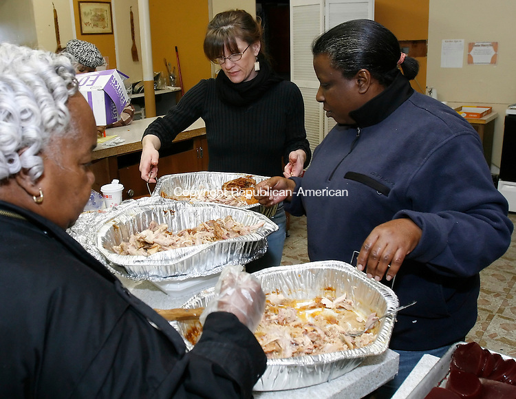 WATERBURY, CT, 11/27/08- 112708BZ01- From left- Bertha &quot;Mother&quot; Jackson, Connie Hunter, and Tori Moore, members of The House of Joy and Praise Outreach Center, prepare Thanksgiving Day meals to be delivered Thursday,<br /> Jamison C. Bazinet Republican-American