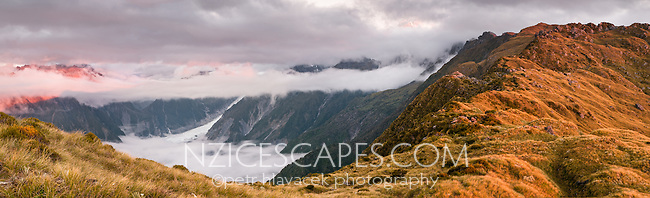 Sunset over Fox Glacier with Aoraki, Mt. Cook 3724m and Mt. Tasman 3497m in clouds, seen from Mt. Fox, Westland Tai Poutini National Park, UNESCO World Heritage Area, West Coast, New Zealand, NZ