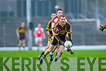Seamus Flynn Currow gets to the ball ahead of Rathmore Mark Reen during their O'Donoghue cup semi final in Fitzgerald Stadium on Sunday
