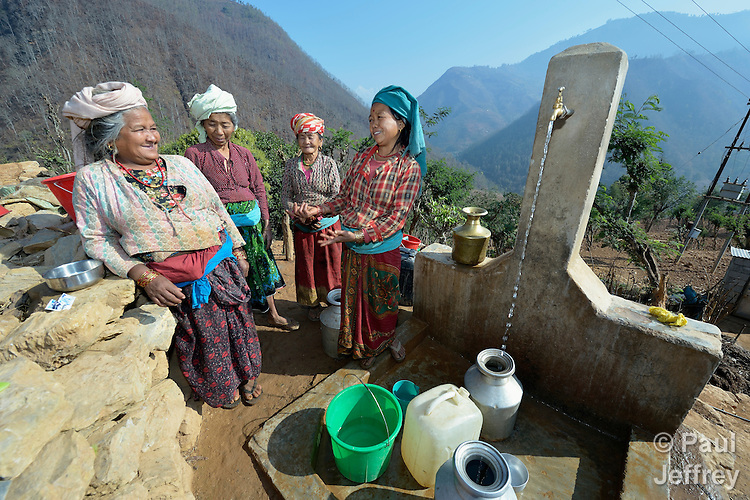 Women gather at a community water tap in Salang, a village in the Dhading District of Nepal where Dan Church Aid, a member of the ACT Alliance, has provided a variety of support to local villagers in the wake of a devastating 2015 earthquake. The village's water system was destroyed by the quake, forcing women to walk two hours or more to a nearby river to fetch water. Working with a local organization, the Forum for Awareness and Youth Activity, the ACT Alliance rebuilt the village's water system.