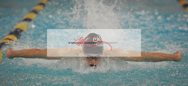 Chugiak's Remington Holtman in the 100 Butterfly at Bartlett High Saturday, Oct. 29, 2016.  Photo for the Star by Michael DInneen